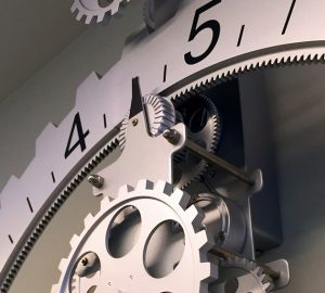 A precision clock in the Sanoudos Kapakian Orthodontic Clinic represents the practice's philosophy