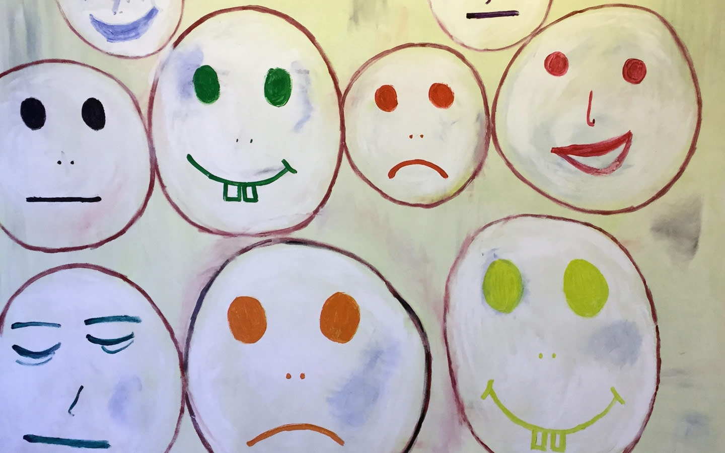 Children's drawings of faces in the Sanoudos Kapakian Orthodontist Clinic in Glyfada, Athens