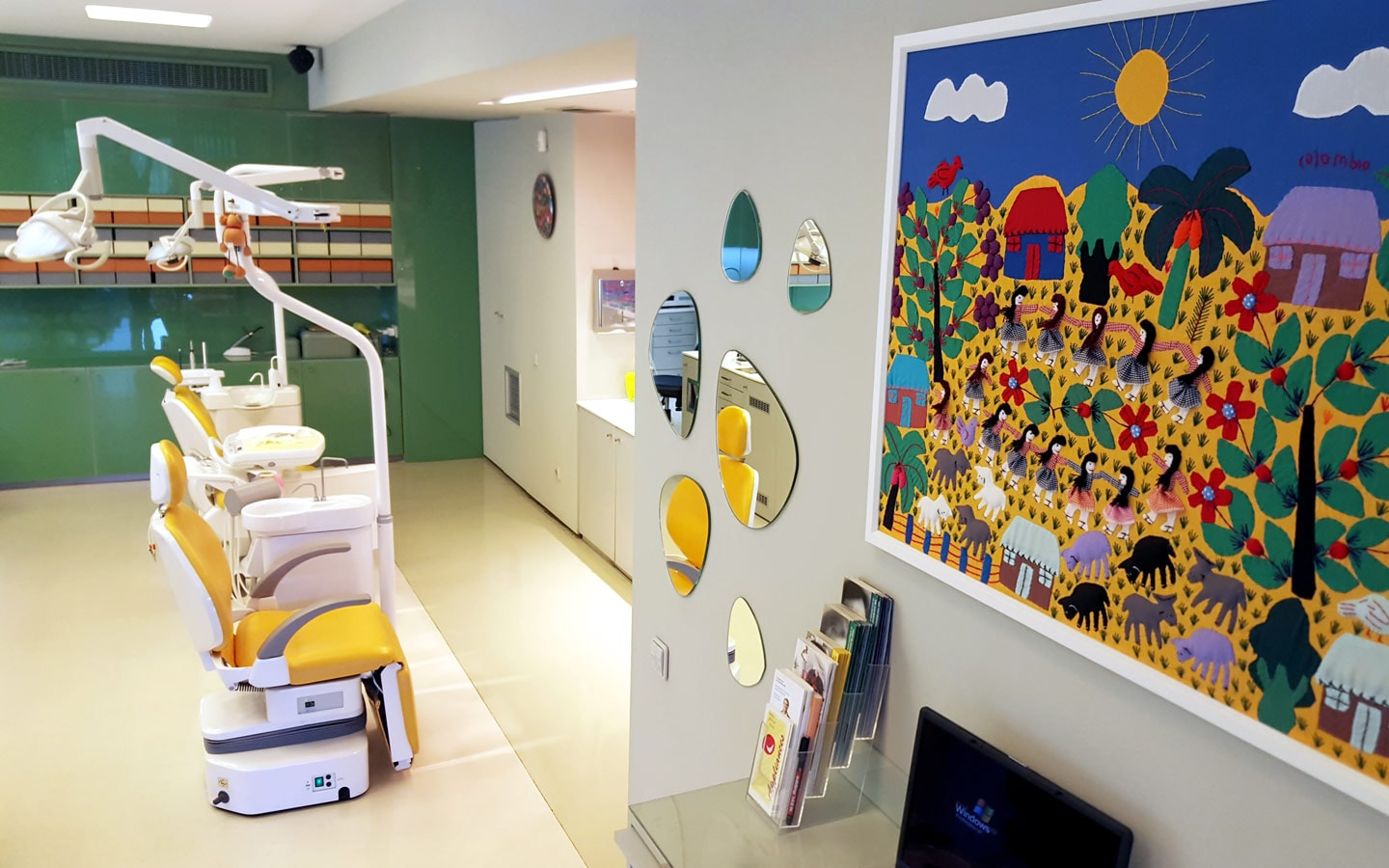 Kids' artwork & treatment chairs in Sanoudos Kapakian cosmetic orthodontic dental practice in Athens