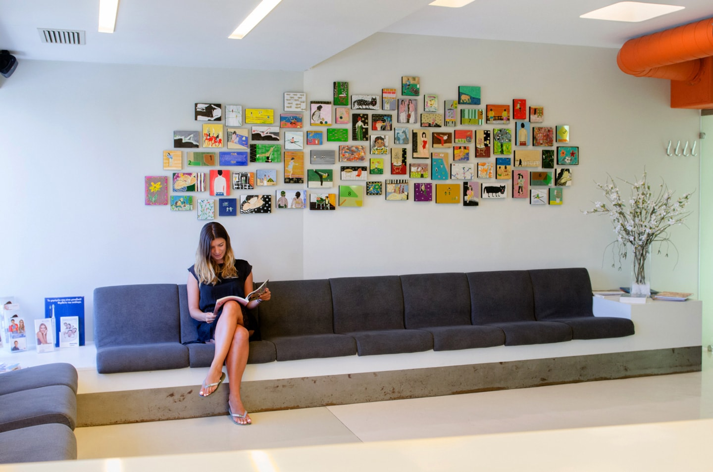 Lady waits for orthodontic treatment in the Sanoudos Kapakian practice reception in Glyfada, Athens
